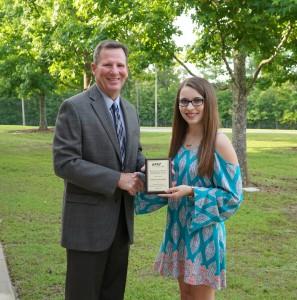 Trustee Sam Walker presents scholarship award to Bethany Reynolds.