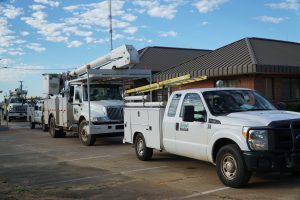 EREC trucks roll out of the EREC headquarters to provide restoration efforts in the Keystone Heights area of Florida.