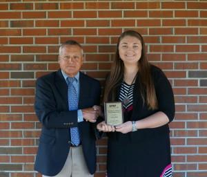 Trustee Dale Westmoreland presents scholarship award to Olivia Britt.